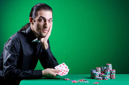 Player in casino and chips photo