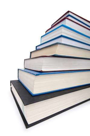 Books in high stack isolated on white Stock Photo - 12349469
