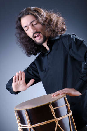 Man playing drum in studio  photo