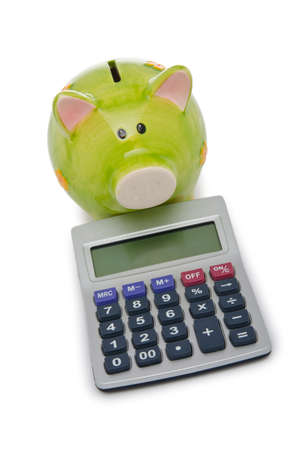Calculator and piggy bank on white photo