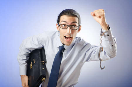 Businessman with handcuffs running away Stock Photo - 12471398