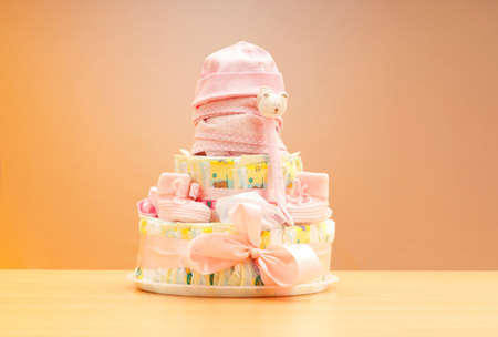 Cakes made of diapers on white photo