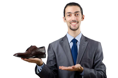 Man with a selection of shoes Stock Photo - 12471374