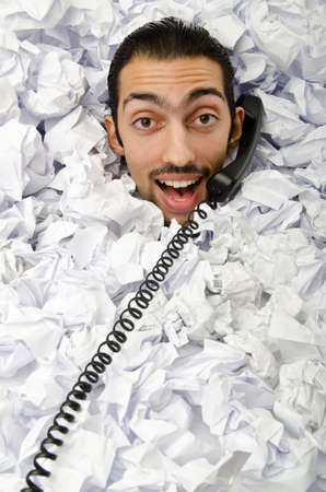 Man with lots of crumpled paper Stock Photo - 12471656