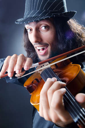 Gypsy violin player in studio Stock Photo - 12472207