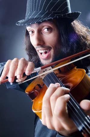Gypsy violin player in studio Stock Photo - 12472207