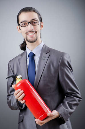 Man with fire extinguisher in firefighting concept photo