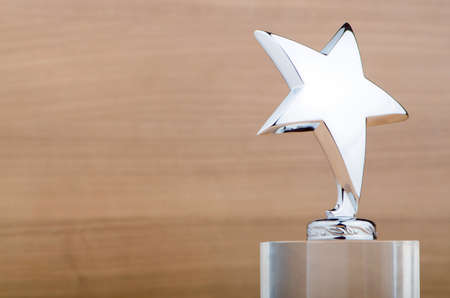 Star award against wooden background photo