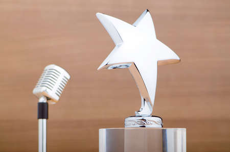 Star award against wooden background Stock Photo - 12346193