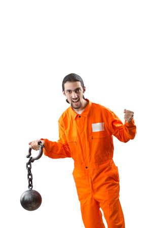 Criminal in orange robe in prison Stock Photo - 12472344