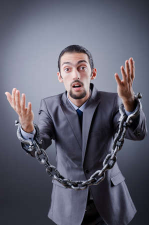 Arrested businessman in studio shooting Stock Photo - 12472737