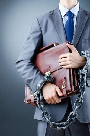 Arrested businessman in crime concept photo