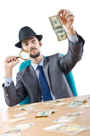 Detective detecting fake dollar banknotes photo