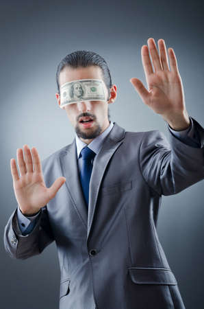 blinded: Businessman blinded with money