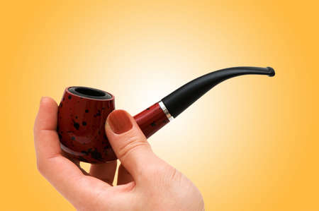 Hand with the smoking pipe photo