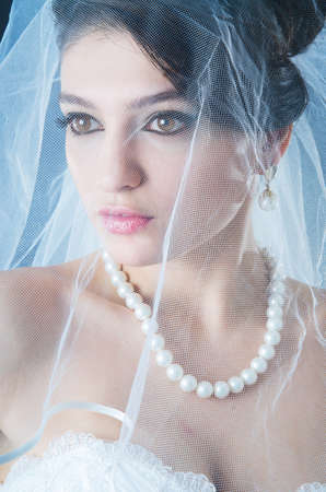 Beautiful bride in studio shooting photo