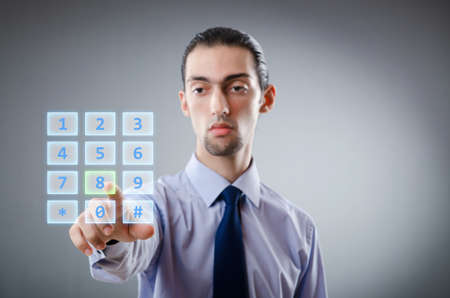 num: Businessman pressing virtual buttons Stock Photo