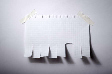 tearaway: Tear off paper notice on the wall Stock Photo