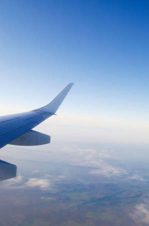Wing of airplane from window Stock Photo - 12527349