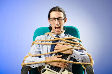 Young businessman tied with rope photo