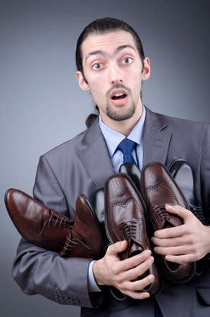 Man with a selection of shoes Stock Photo - 12556390