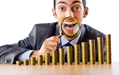 Businessman with golden coins photo
