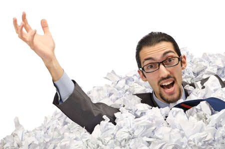 corporate waste: Man with lots of waste paper