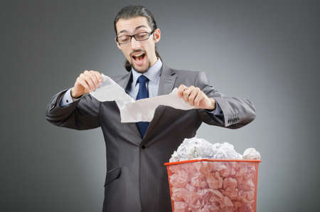 wasted: Man with lots of wasted paper Stock Photo