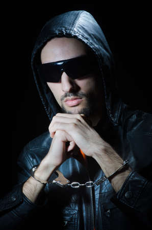 Young criminal with handcuffs Stock Photo - 12556482