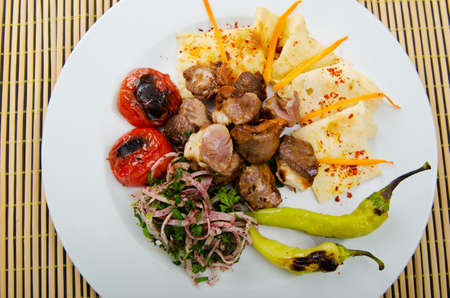 Meat cuisine - kebab served in plate photo