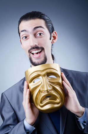 Businessman with mask concealing his identity Stock Photo - 12556427