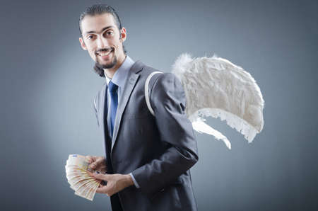 Business angel with money Stock Photo - 12556463