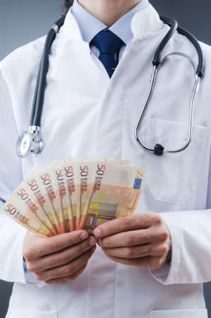 hospital fees: Doctor with euro money