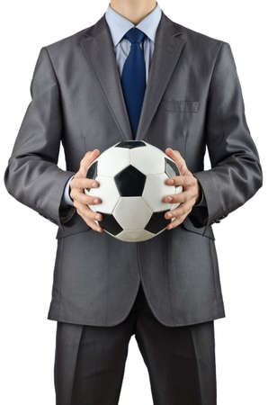 Businessman holding football on white Stock Photo - 12531042