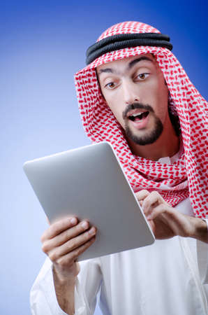Young arab with tablet computer Stock Photo - 12556161