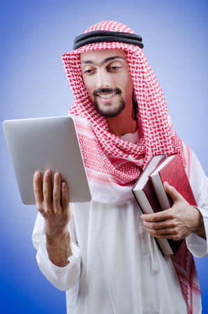 thoub: Young arab with tablet computer