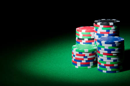 poker table: Casino concept with chips and cards