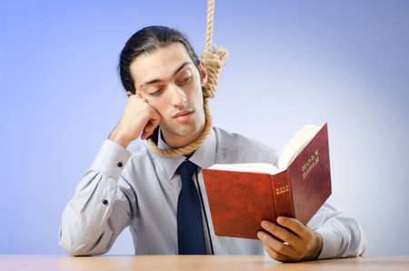 Businessman reading bible before hanging himself photo
