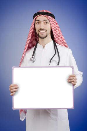 Arab with blank board Stock Photo - 13305949