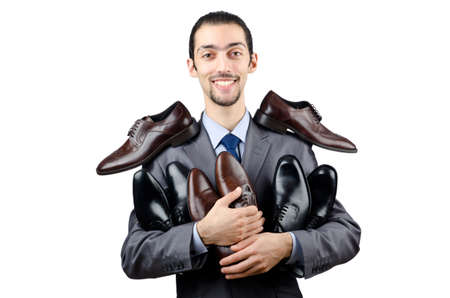 footgear: Man with a selection of shoes Stock Photo