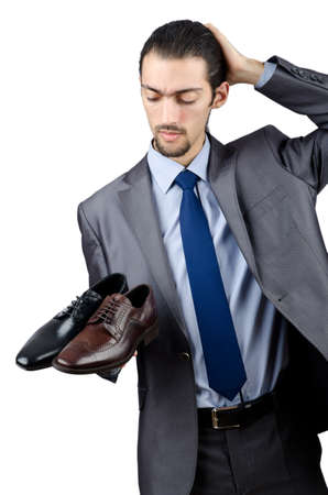 Man with a selection of shoes photo