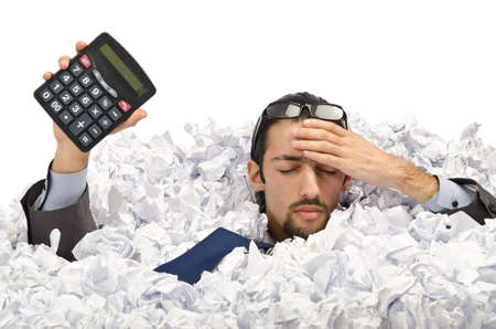 Man with lots of waste paper photo