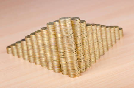 Golden coins in high stacks photo