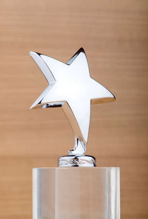 Star award against wooden background Stock Photo - 12515357