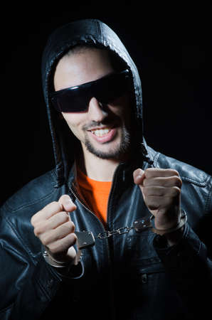 Young criminal with handcuffs Stock Photo - 12556214