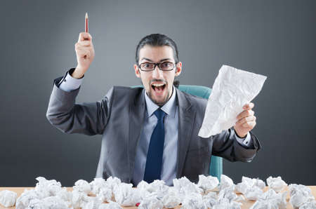 Businessman throwing paper away photo