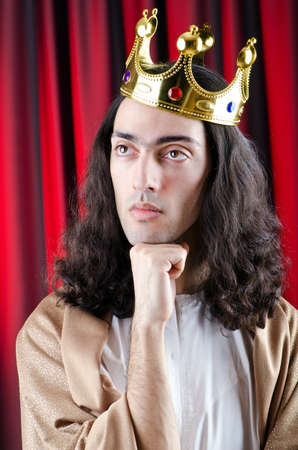 King with crown against background photo