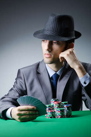 texas hold em: Man playing in the casino