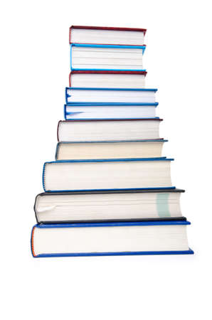 Books in high stack isolated on white Stock Photo - 12580572