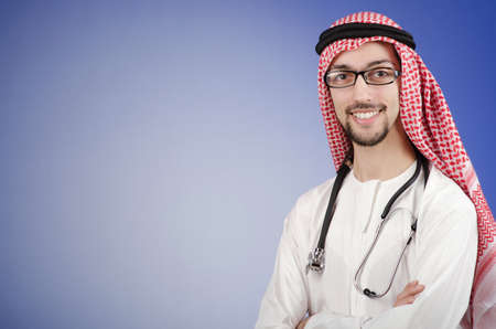 Arab doctor in studio shooting photo